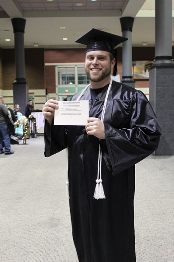 Mac Grieser with his diploma